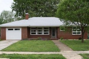 White roof Brick house. Plus a good explanation of the benefits of white roofs.