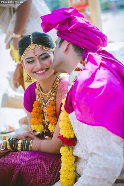South Indian Bride - Bride in a Purple and Gold Saree with a Gold Matha Patti | WedMeGood #wedmegood #indianbride #indianwedding #bridal #southindianbride #southindianwedding #candidcoupleshot #coupleshot #goldjewelry