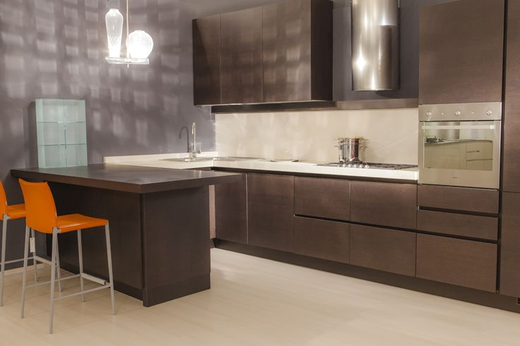"We are selling this beautiful ""Axis"" kitchen by Zampieri Cucine complete with cabinets in brown wengé, Electrolux Rex stove, oven, dishwasher and fridge, inox steel hood, sink and taps and ivory worktop. All with a discount of 40%. Original price: €13,750 Our price: €8,300  An occasion not to be missed.  Transport and fitting not included. Come to our store or call us for more details.  #kitchen #cucine #homedecor #designsale #design #buydesign #sconti #arredi #casa #modern"