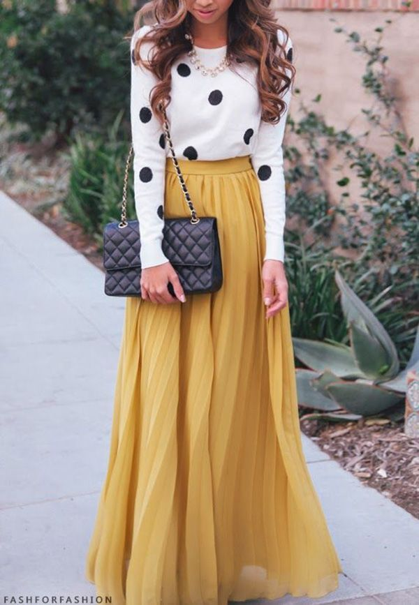 Shop this look for $36:  http://lookastic.com/women/looks/white-and-black-polka-dot-crew-neck-sweater-and-black-leather-crossbody-bag-and-mustard-pleated-maxi-skirt/3960  — White and Black Polka Dot Crew-neck Sweater  — Black Leather Crossbody Bag  — Mustard Pleated Maxi Skirt