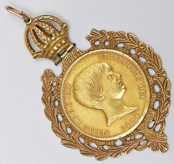 """Rara moeda brasileira de ouro 22k, de 10.000 reis do ano de 1834 """" Pedro menino"""", encastoada"""