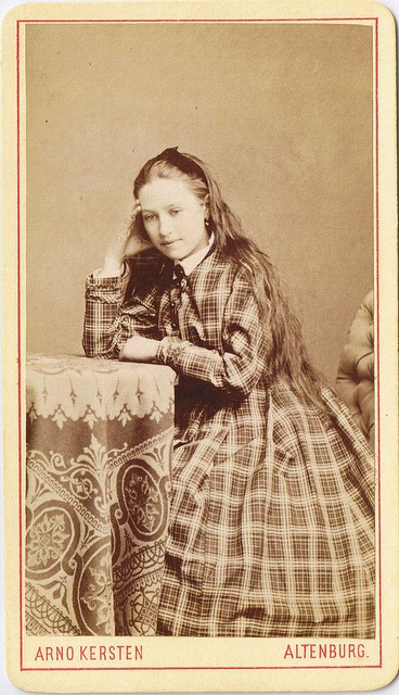 There is an almost Alice in Wonderland-like quality about this immensely pretty young German Victorian lady.