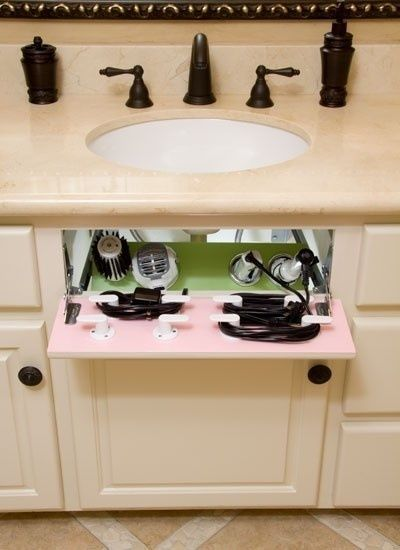 BEST IDEA EVER ♥ Turn the fake drawer in your cabinet into a hair dryer/straight iron storage space..