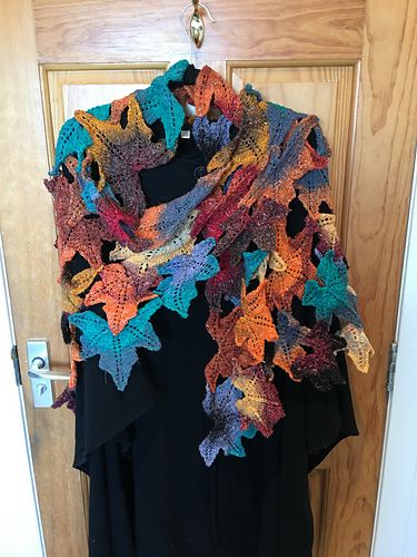 IDK about a shawl, but this leaf pattern could be used in many decorative applications. Buy through Ravelry: Lady-Macbeth's Autumn Leaves shawl