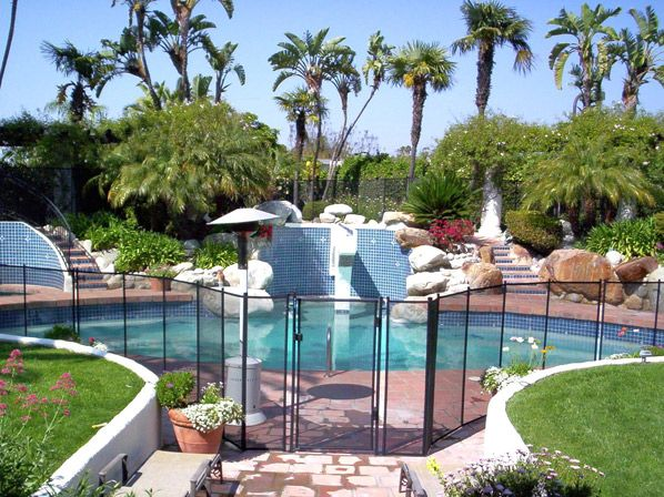 17 best ideas about pool fence on pinterest pool ideas pool landscaping and backyard pools for Swimming pool safety fence prices