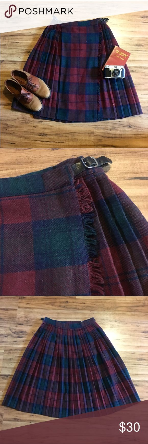 Vintage Tartan Wrap Skirt Amazing vintage Scottish wrap skirt, featuring leather adjustable buckles and perfect pleats front and back! Perfect shades of burgundy, blue and green. Looks awesome with fall colours (and of course black! ) Midi length. 20% wool. Lightly worn. NOT URBAN OUTFITTERS marked for exposure ((TAGS: 50s, 60s, retro, pinup, Hell Bunny, Stop Staring, Twin Peaks, Audrey Horne)) Urban Outfitters Skirts Midi