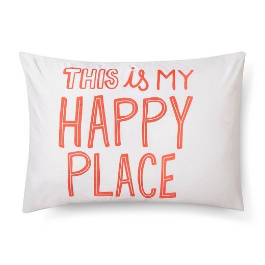 """The Happy Place Pillowcase Standard in White from the Pillowfort Tropical Treehouse collection puts a sweet message where your little one lays their head. The kids' pillowcase in white has a fun font in a peachy color that lets everyone know that snuggled into bed is the perfect spot. """"This is my happy place"""" reads the pillow case, great for a boy's or girl's room."""
