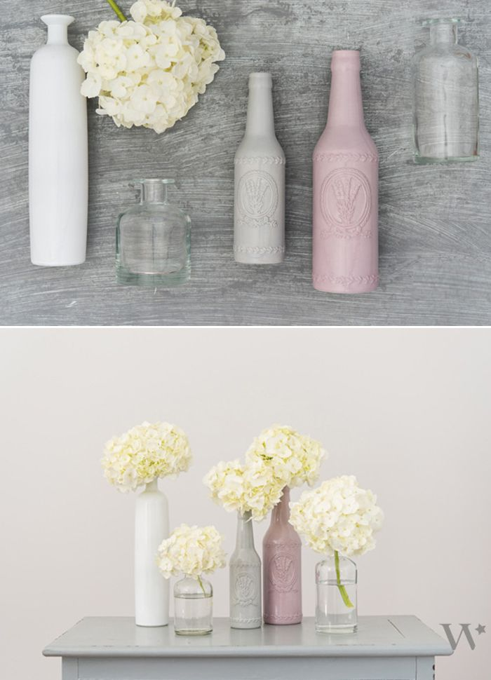 Mix and match bottle vases make a gorgeous (and simple) #DIY tablescape for your wedding! Learn how to create this look here: http://blog.weddingstar.com/wedding-decor-ideas-pretty-on-a-penny-part-2-making-it-yours/
