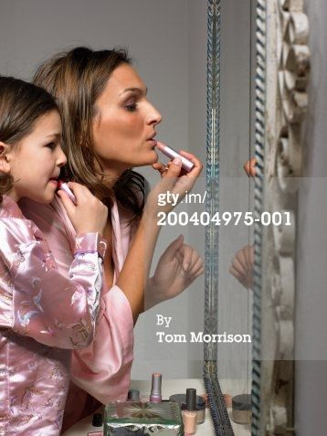 Mom and daughter putting on lipstick together. Cute that they're both in robes. Rollers in hair would be cute, too.
