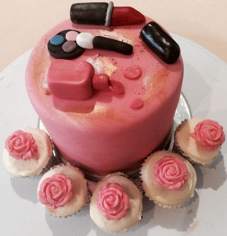 Messy make up desk cake with mini rose cupcakes