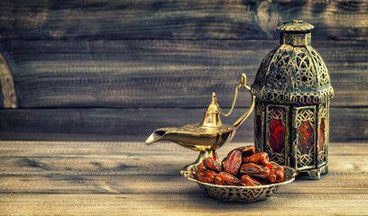 Ramadan lamp and dates on wooden background. Oriental lantern