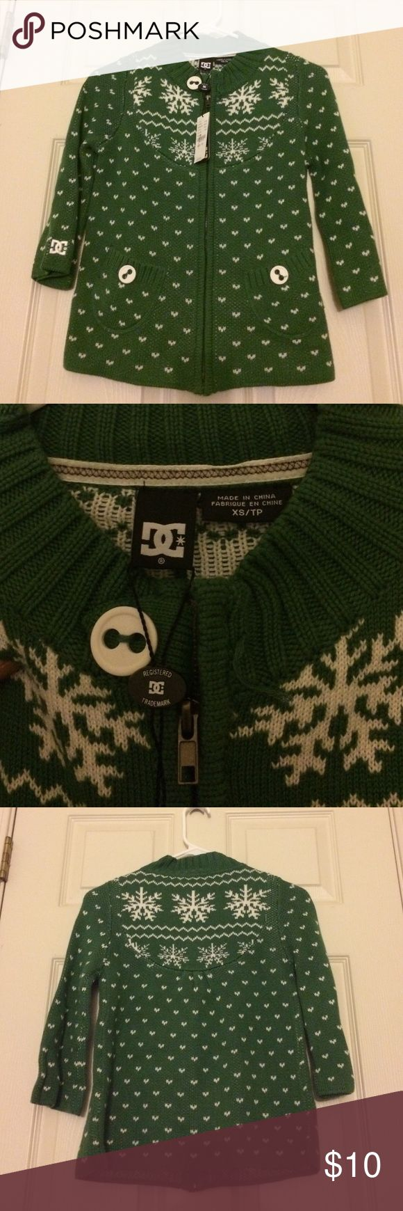 DC Christmas Sweater. I bought this Christmas zip up sweater for an ugly sweater party. There was a button originally missing so it was on sale. Two pockets and 3/4 sleeve. DC Sweaters Cardigans