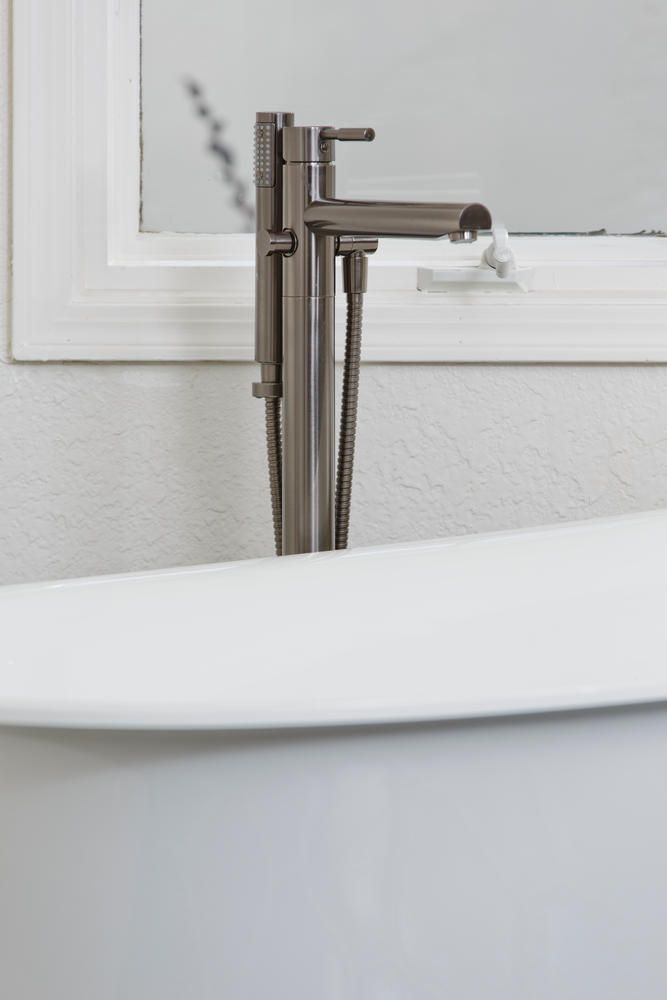 Aquabrass Geo Floormount Tub Filler, Featured In  @SignatureDesignsKitchenBath San Diego Bathroom Design.