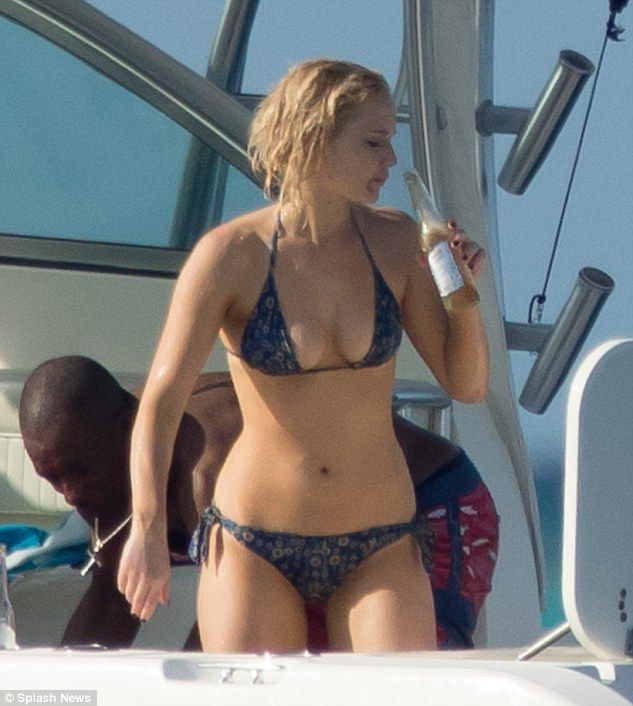 Caribbean queen: Jennifer Lawrence showcased her flawless hour-glass figure as she enjoyed a cold beer during a getaway in The Bahamas
