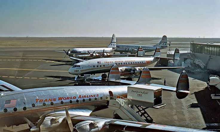TWA Constellations, Pan Am Boeing 377 Stratocruisers in the back. SFO, 1955.