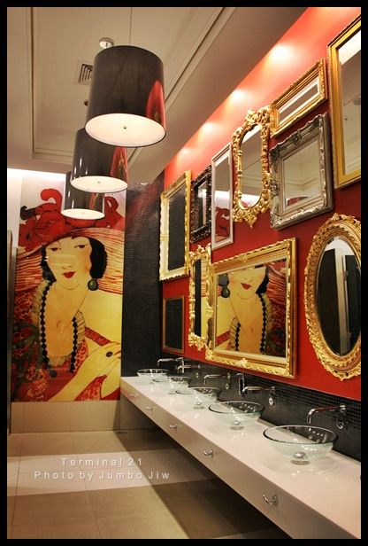 bathroom area with a black and red colour scheme, with an oriental twist. the large pendants lamps over the sink area will create a lot of light.