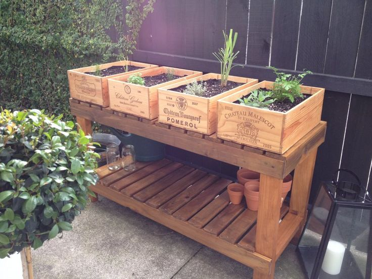 *Potting bench built by my husband then stained by me. *Wine crates as herb planter boxes (drilled holes, fitted metal brackets, stained for weather proofing, lifted the boxes off the ground by 1cm and lined with plastic liner so it doesn't get water logged)