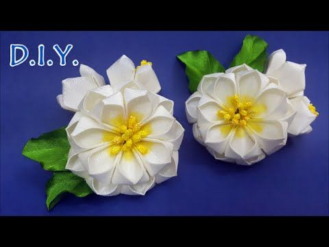 In this tutorial, learn how to make these beautiful Grosgrain Ribbon Kanzashi Flower. It can be attached to a purse, a shirt, a barrette or any other fashion...