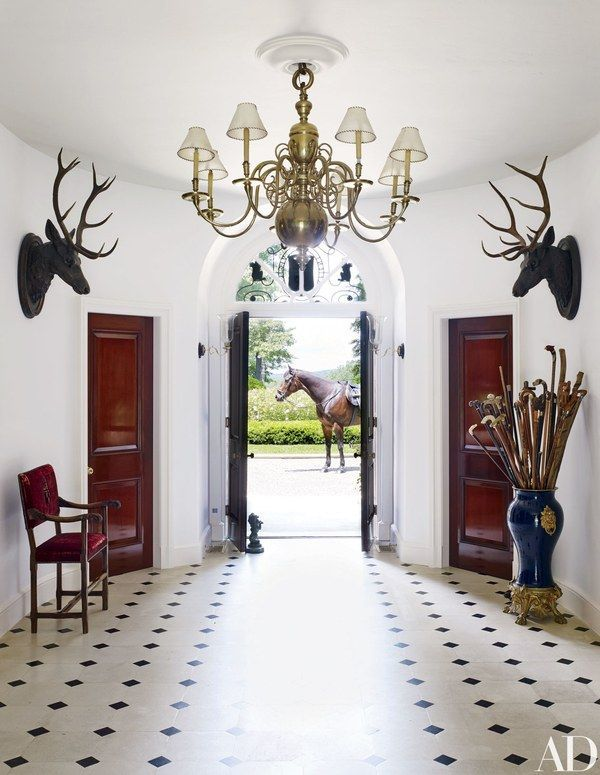 At Ralph Lauren's residence in Bedford, New York, a 19th-century Dutch chandelier presides over the entrance hall | archdigest.com