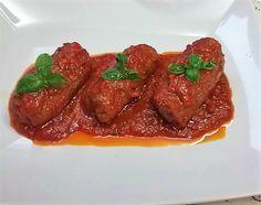Ingredienti: 400g di fettine di vitello 50g di prosciutto cotto 50g di speck a fette 200g di mozzarella 200g di salsa di ciliegino Paté di olive nere Origa