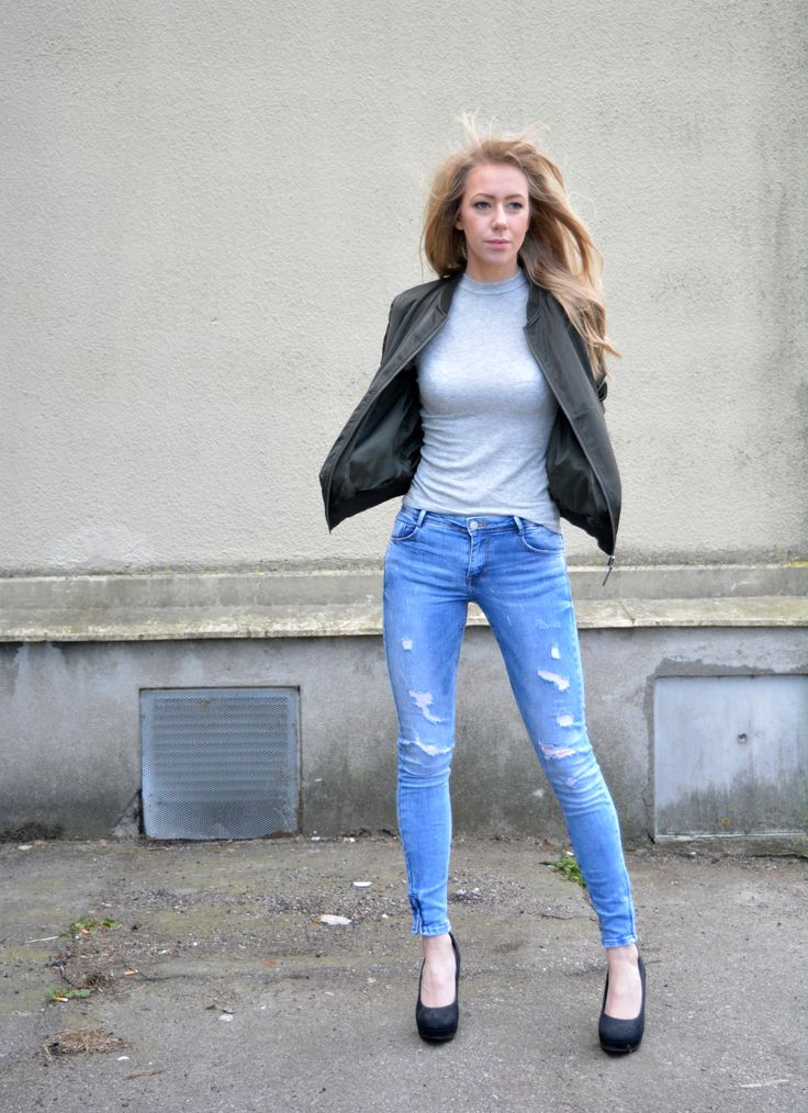 Trashed jeans, green bomber jacket, basic grey tee, heels outfit