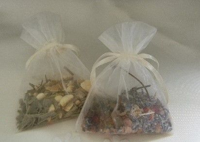 Wedding Favour Bath Sachets. Your own custom blend with a large variety of ingredients to choose from. Infusions with essential oils or fragrance also available for these bath sachets. Many different colours of organza bags to choose from and personalized tags also available.