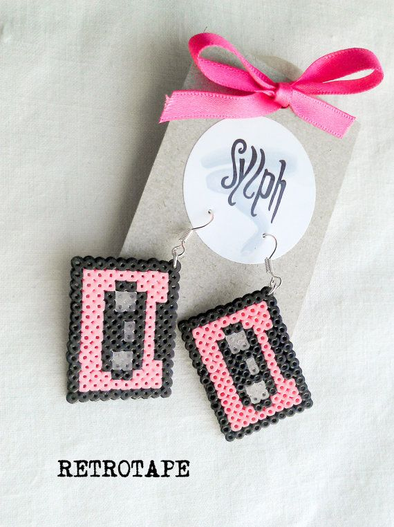 Pixelated pink geeky Retrotape cassette earrings made of Hama Mini Beads made with love for pixel-perfect 8bit music lovers by SylphDesigns