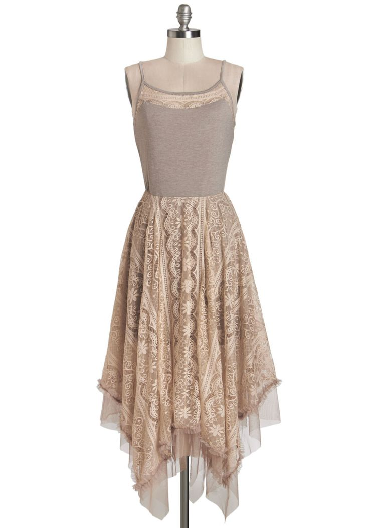 With a dreamy handkerchief hem and subtle mauve hue, this dress is a fairytale come true!