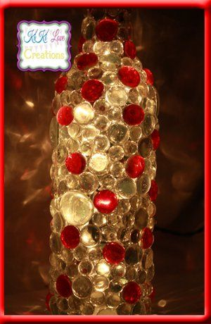 This was originally called an illuminated WINE bottle. With dollar store stones, empty 2 liter soda bottle, simple lamp kit (using a low watt bulb (old Christmas light?). Fill 2 liter with cold water to keep from melting bottle with hot glue or use low heat glue. Cover only as much of bottle as you want, remove rest after cooling. Complete with lamp kit or DYI string light.  Remember low wattage!