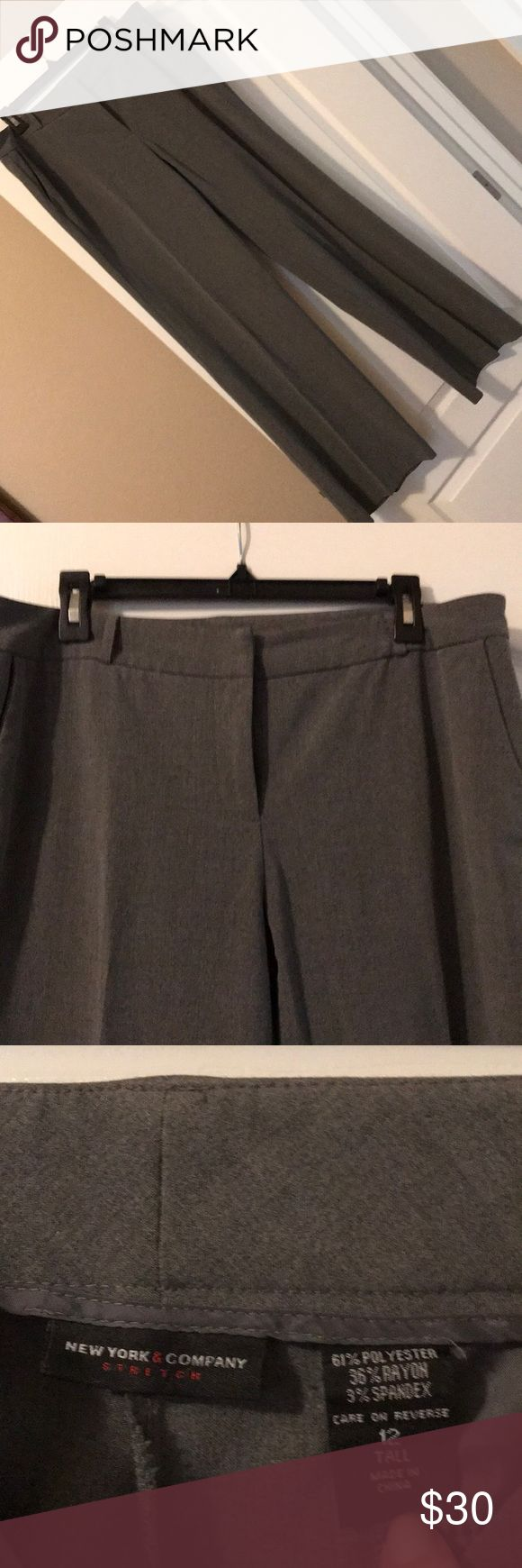 NY and Company grey dress pants NY and Company - Grey dress pants - great business attire.  Like new.  Pleated front, excellent condition.  These pants are super comfortable and go with everything.  They are perfect for those tall women.    I lost weight and am cleaning out my closet.    If you bundle I will offer more discounts. New York & Company Pants Trousers