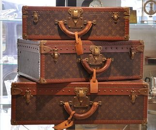 I can probably afford these  Vintage Louis Vuitton suitcases.