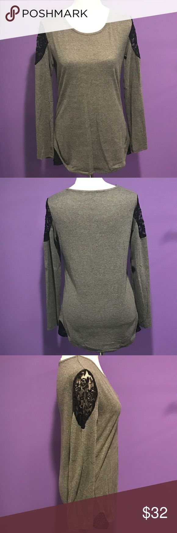 Grey Long Sleeve Top with Black Lace Grey Long Sleeve Top with Black Lace on Shoulder and Hip. This is NWOT Retail. Measurements Available Upon Request Tops Tees - Long Sleeve