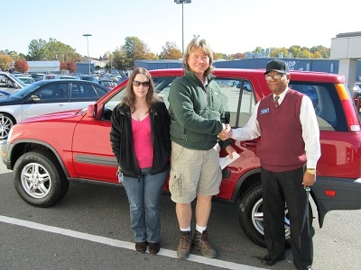 Folger Subaru Sales Consultant Bill Barber with Mr. Simpson and his 1999 Honda CR-V EX SUV!