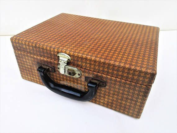 Vintage small suitcase is a hard shell houndstooth case. 1940s makeup case has a large inside mirror, organizer pouch and comes with the original key. These were sweet kids overnight bags when going to grandmas back in the 1940s and 1950s. It would make a nice case for wedding cards or baby shower cards. It is in good rustic vintage condition. The inside mirror is still usable but dull from age. The inside in clean and fabric lined. The outside has some scuffs and shows age. The front latch…