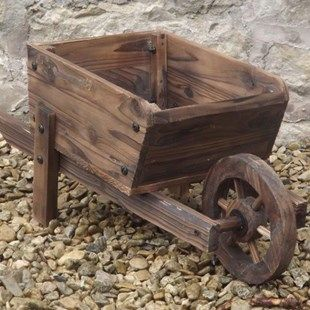 Small Flat Pack Wheelbarrow Planter Decorative Rustic Wheelbarrow Planter Size: Length 67cm. Width 25cm. Depth 13cm. Height 28cm.A delightful, burnt-wood, decorative rustic wheelbarrow which will make a perfect holder for a pretty plant http://www.MightGet.com/january-2017-11/small-flat-pack-wheelbarrow-planter.asp