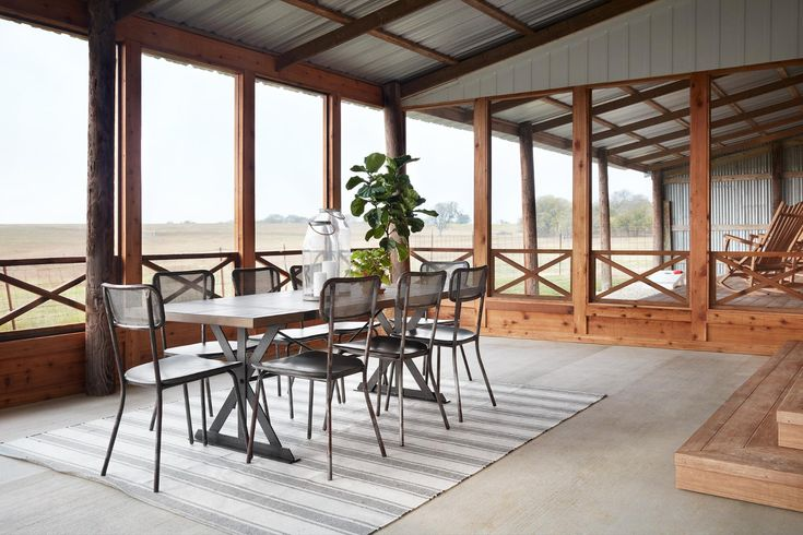 There wasn't enough room in the floor plan to add in a formal dining room, so we decided to capitalize on this beautiful view and create an outdoor eating area. We screened it in to keep the bugs away, but also wanted this to be an area they could use year round regardless of weather.