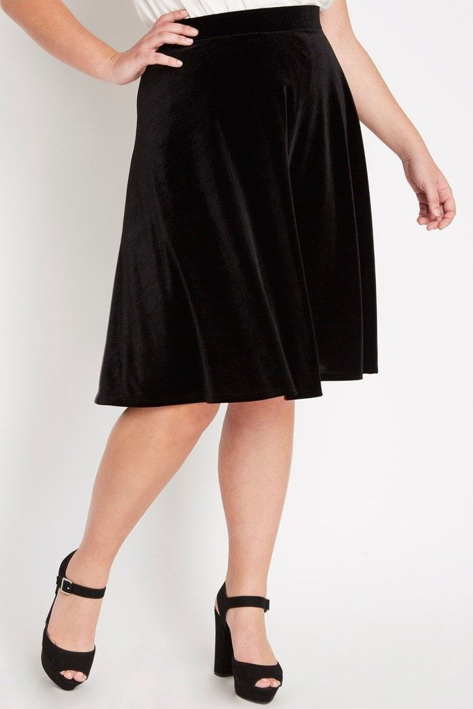 Comfortable velvet material creates an elegant look for this flowy midi skirt. Skirt is unlined. Content & Care • 90% Polyester 10% Spandex • Machin