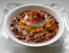 Low Carb Taco Soup Ingredients: 1 lb. lean ground beef 1 pkg. taco seasoning or create your own spice blend 1 can pinto or chili beans 1 can diced tomatoes shredded sharp cheddar cheese sour cream salsa