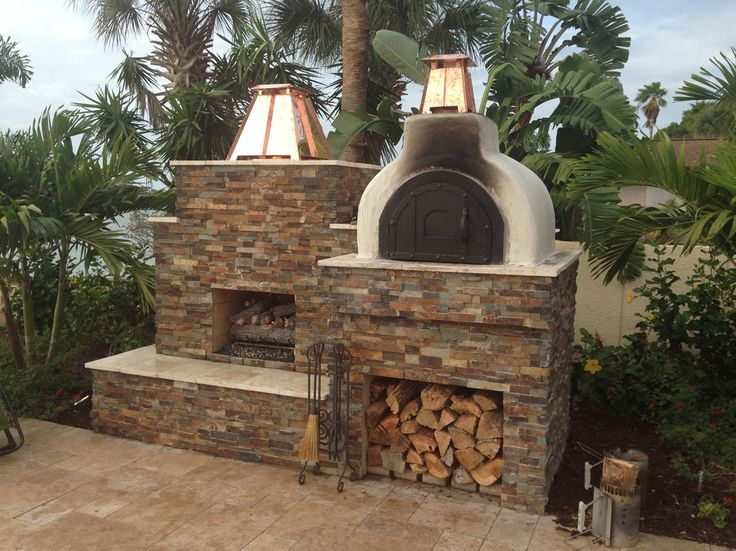 This gorgeous outdoor fireplace and pizza oven combines matching stone veneer with a bit of - Outdoor stone ovens ...