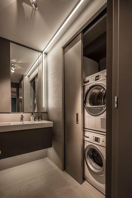 Wasmachine en droger in kleine badkamer