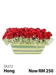 24 red roses in a square arrangement.