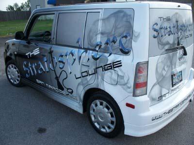 Vehicle wrap and printed window graphics