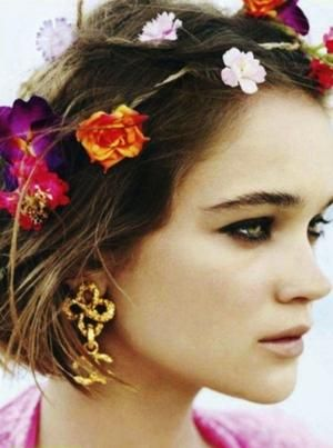 Combines nature with glamor, edgy, bold, warm colors. Typically flower crowns are put on girls with long, wavy hair and whimsical clothes. Instead she has a short, distinct hair cut, dark make up, and a bold earrings on.
