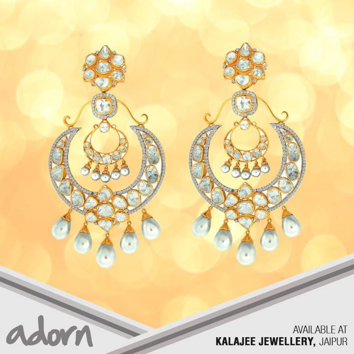 Yellow #gold #polki- and #pearl-set chand baalis festooned with florets shelter a smaller version of #baalis in its framework. To know more about fine #Jewellery visit our website: www.kalajee.in
