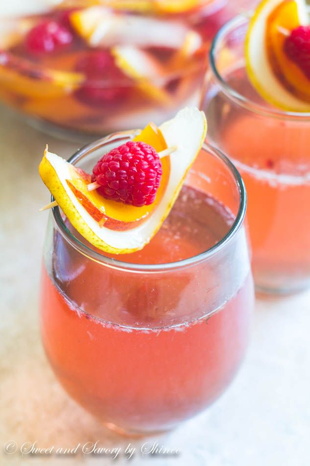 Pears, peaches and raspberries are soaked in rose wine and touch of triple sec. Not your usual sangria, but it is SO good!