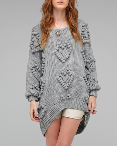 Heartless Knit One Teaspoon Over-sized chunky knit sweater with heart shapes bordered by large pom-poms knitted throughout from One Teaspoon. $225.00