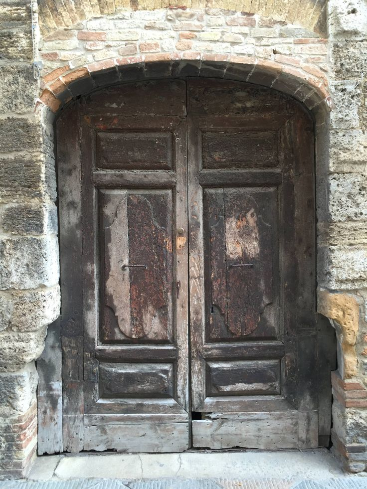 One of the many medieval doors in the ancient town of San Gimignano, Italy.