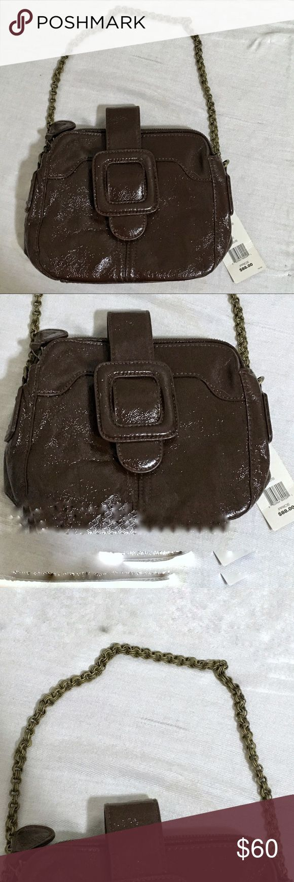 NWT French Connection Handbag New with tags French Connection handbag. Shiny color described on tag as licorice. 9 inches wide by 7 inches tall. Buckle on front snaps closed. Two interior pockets, one is zippered. The zippered compartment has another small zippered pocket. Chain strap about 21 inches, non adjustable. Note some minor damage seen in pictures. .                     💵 Reasonable Offers Welcome 💰Bundle Discount 📦Ships in 1-2 days French Connection Bags Mini Bags