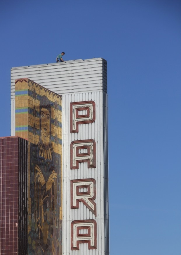 High on the Paramount Sign, Oakland, California By Ricardo Moran.