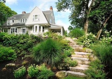 Redesigned and replanted steep hillside w plantings and grasses. Added w repurposed granite steps.